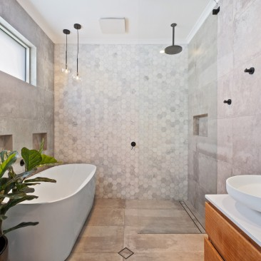 Modern bathroom with matte black tapware, hexagonal tiles and fiddle leaf fig, Harris Street, Glenelg East