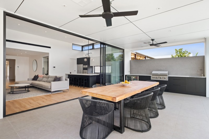 Open plan living area opening up to outdoor kitchen and dining area, Harris Street, Glenelg East
